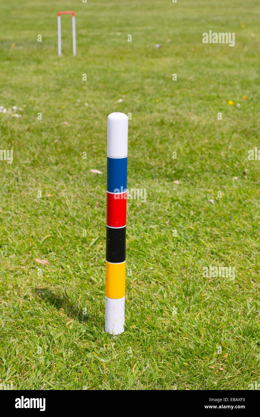 Croquet centre peg. - Stock Image