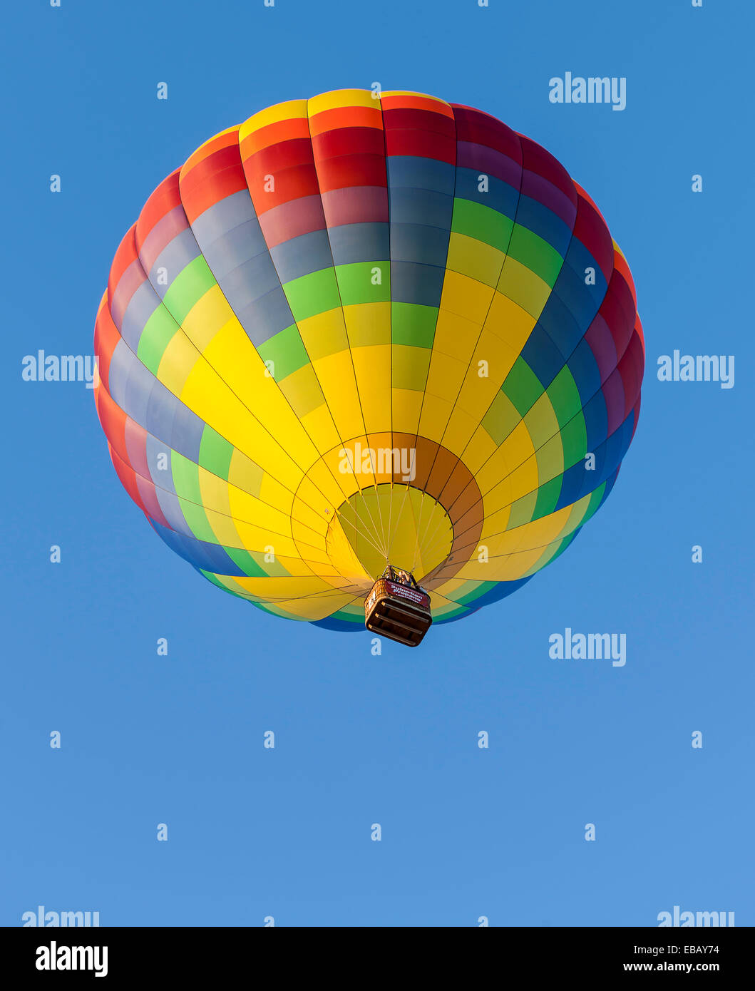Queesbury, New York, USA - September 20, 2013: A hot air balloon soars in the sky at Adirondack Balloon Festival - Stock Image