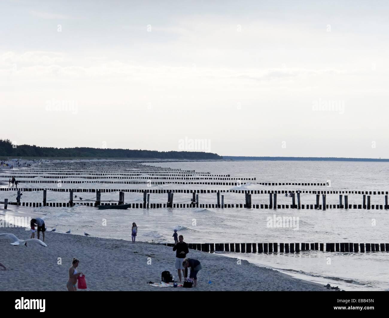 Baltic Sea beach between body of water breakwater city coast coastal coastline color image easternmost Europe Germany - Stock Image