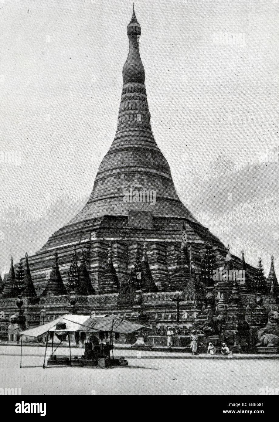 Schwemodo Pagoda at Pegu, entirely gilded edifice  It rises more than 100 meters, it sides, 50 meters wide, are - Stock Image