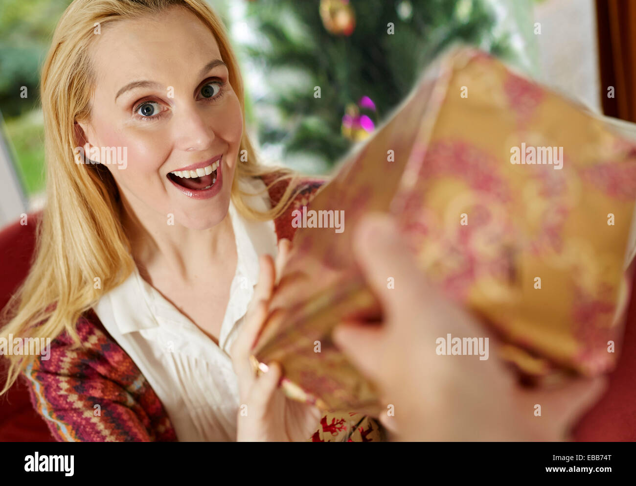 Woman receiving present - Stock Image