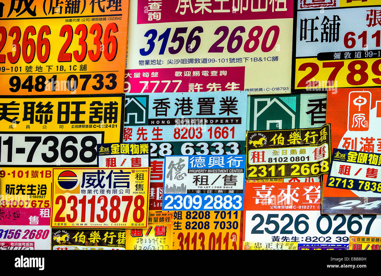 Hong Kong, advertisments with phone numbers in the old city center - Stock Image