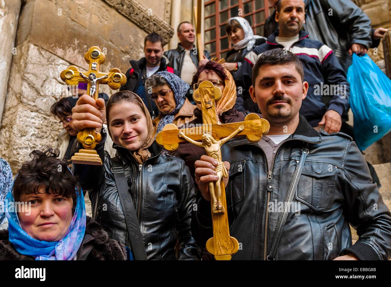 Armenian pilgrims outside the Church of the Holy Sepulchre site of the last five stations of the Cross and venerated Stock Photo