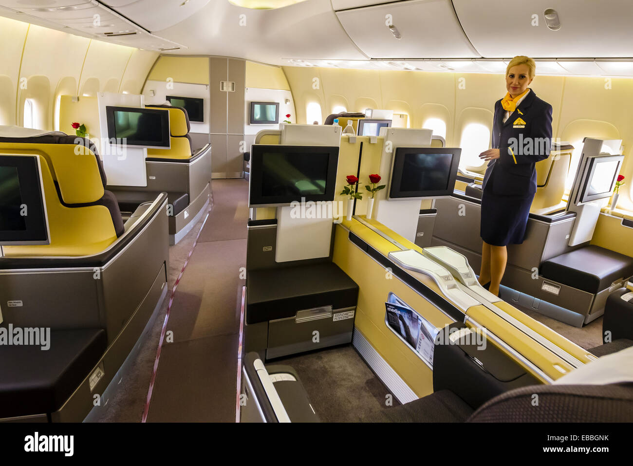 First class cabin of a Lufthansa 747 jet at Frankfurt Airport Germany. - Stock Image