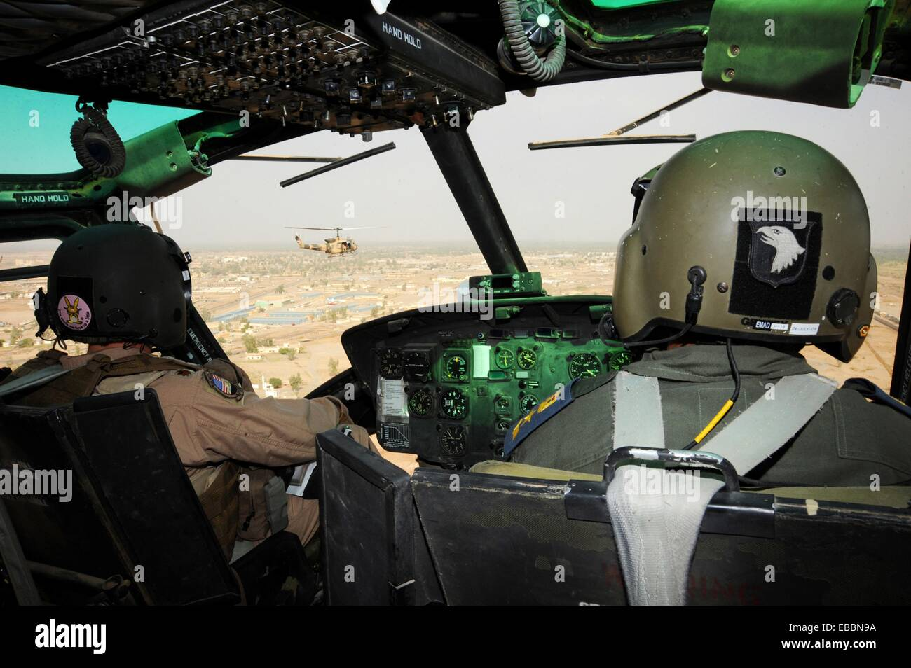 Maj  Jack Swinehart left demonstrates aerial formation flying procedures for an Iraqi pilot over Camp Taji, Iraq, - Stock Image