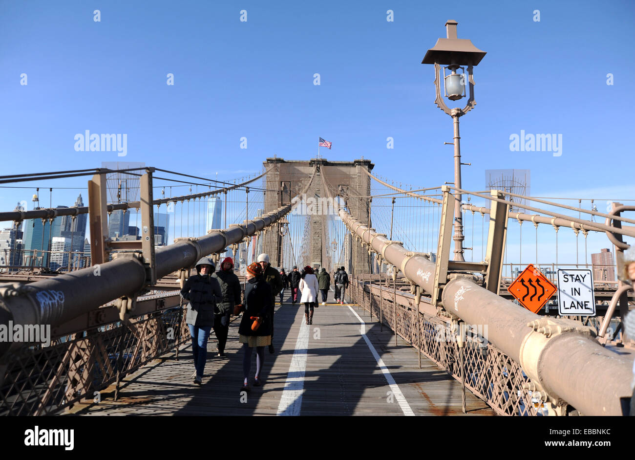 Manhattan New York USA November 2014  - Tourists crossing on Brooklyn Bridge looking back toward Manhattan Financial Stock Photo