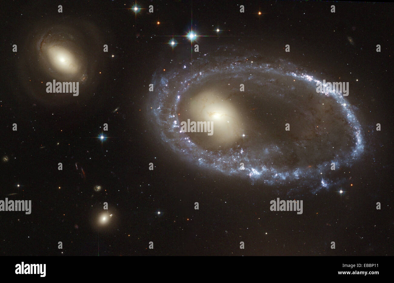 Blue Stars Ring Nucleus of Galaxy AM 0644-741. Resembling a diamond-encrusted bracelet, a ring of brilliant blue - Stock Image