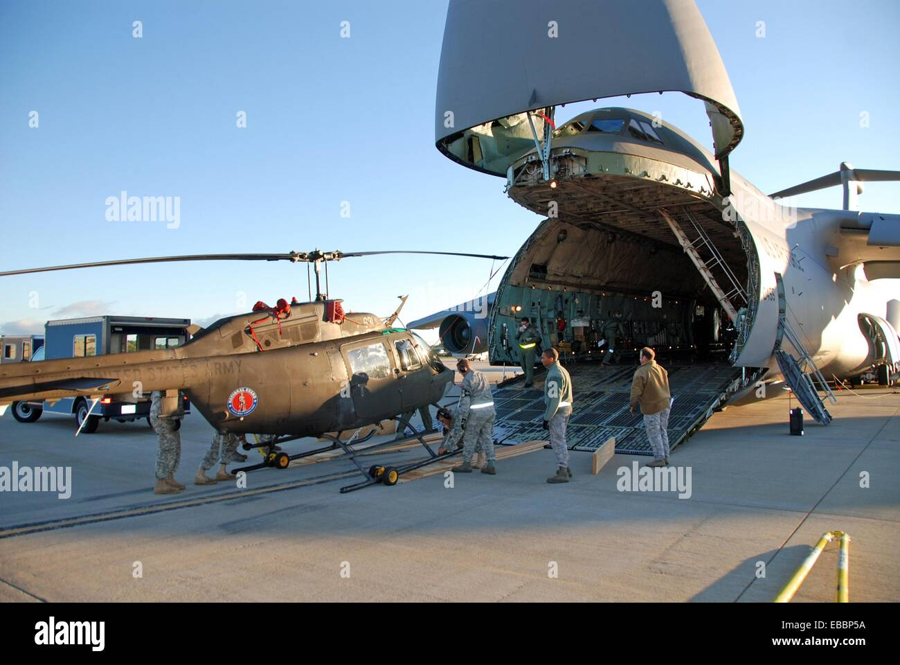 New York Army National Guard Soldier unload an OH-58 Kiowa Sept 17, 2010, at Cape Town International Airport, South - Stock Image
