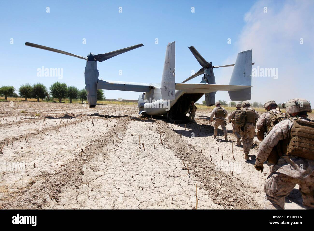 100609-M-0301S-148   U S  Marines board a V-22 Osprey aircraft at Control Base Karma in the Helmand province of Stock Photo