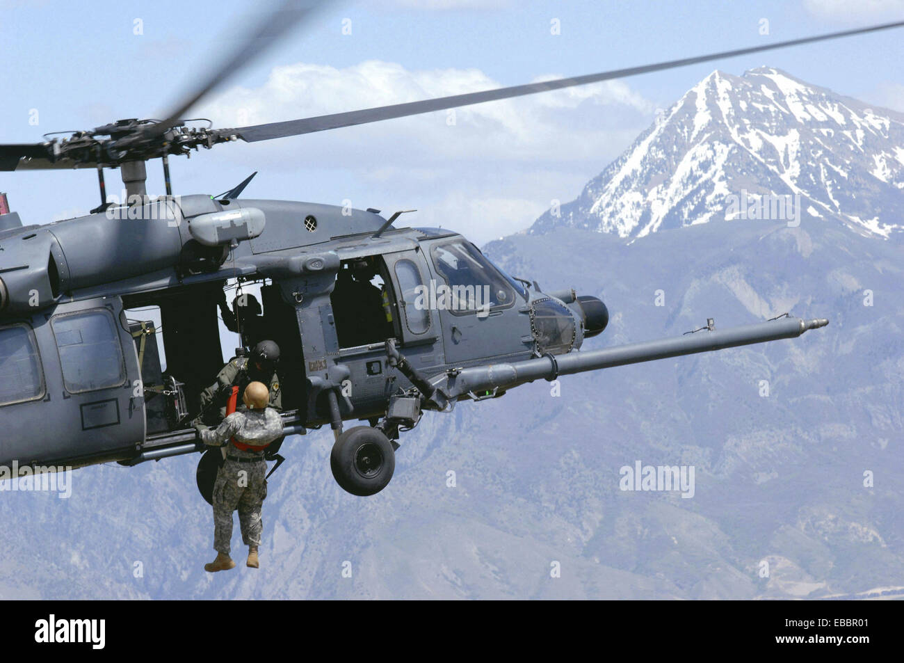 A Utah Army National Guard Soldier,19th Special Forces unit is lifted on board an Air Force HH-60 Pave Hawk helicopter - Stock Image
