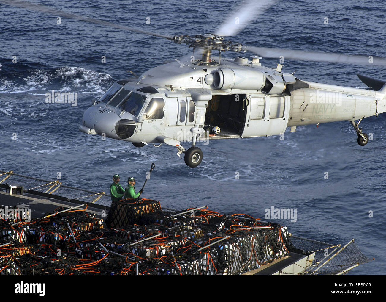 ARABIAN SEA (April 14, 2007) - Personnel from USNS Bridge (T-AOE 10) attach pallets of supplies to an MH-60S Seahawk, - Stock Image