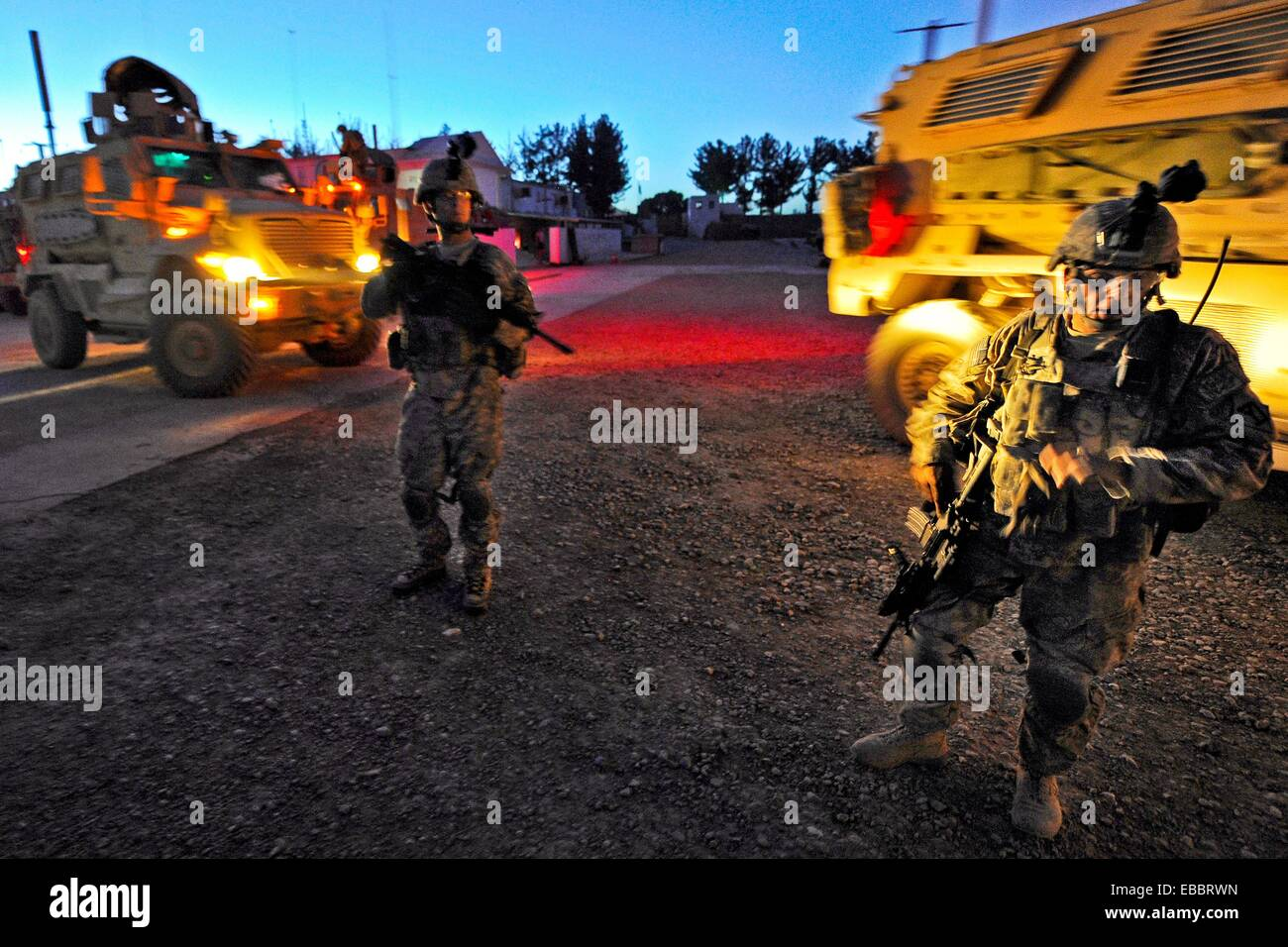 Security personnel from Provincial Reconstruction Team Zabul depart for the Zabul Provincial Hospital after an improvised Stock Photo