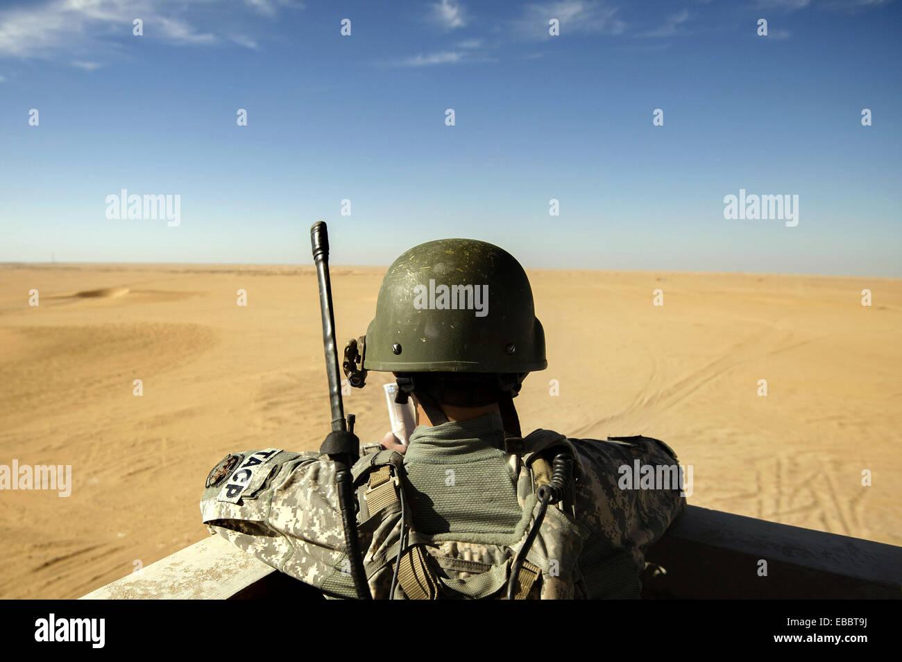 Senior Airman Justin Tamayo monitors incoming combat aircraft during a joint live-fire exercise Oct. 23, 2013, at - Stock Image