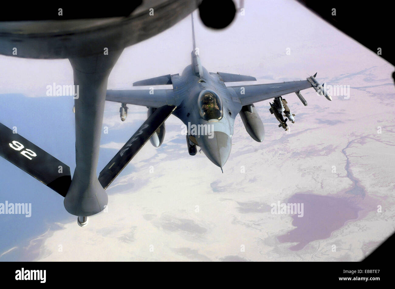 An F-16 Fighting Falcon approaches a KC-135 Stratotanker May 19 over central Iraq to refuel while supporting Operation - Stock Image