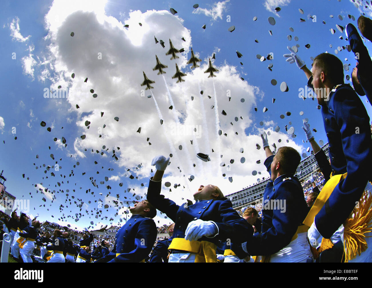 U.S. Air Force Academy graduates throw their hats in the air May 30 as the Air Force Thunderbirds fly overhead signaling Stock Photo