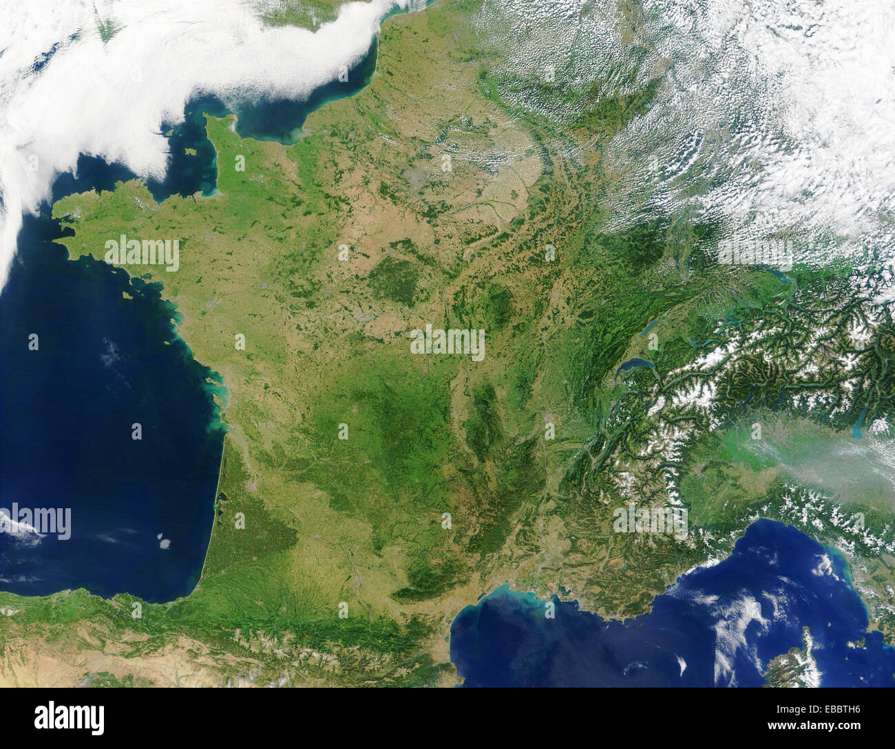 An unusually cloud-free France shows green and tan in this true-color Moderate Resolution Imaging Spectroradiometer - Stock Image