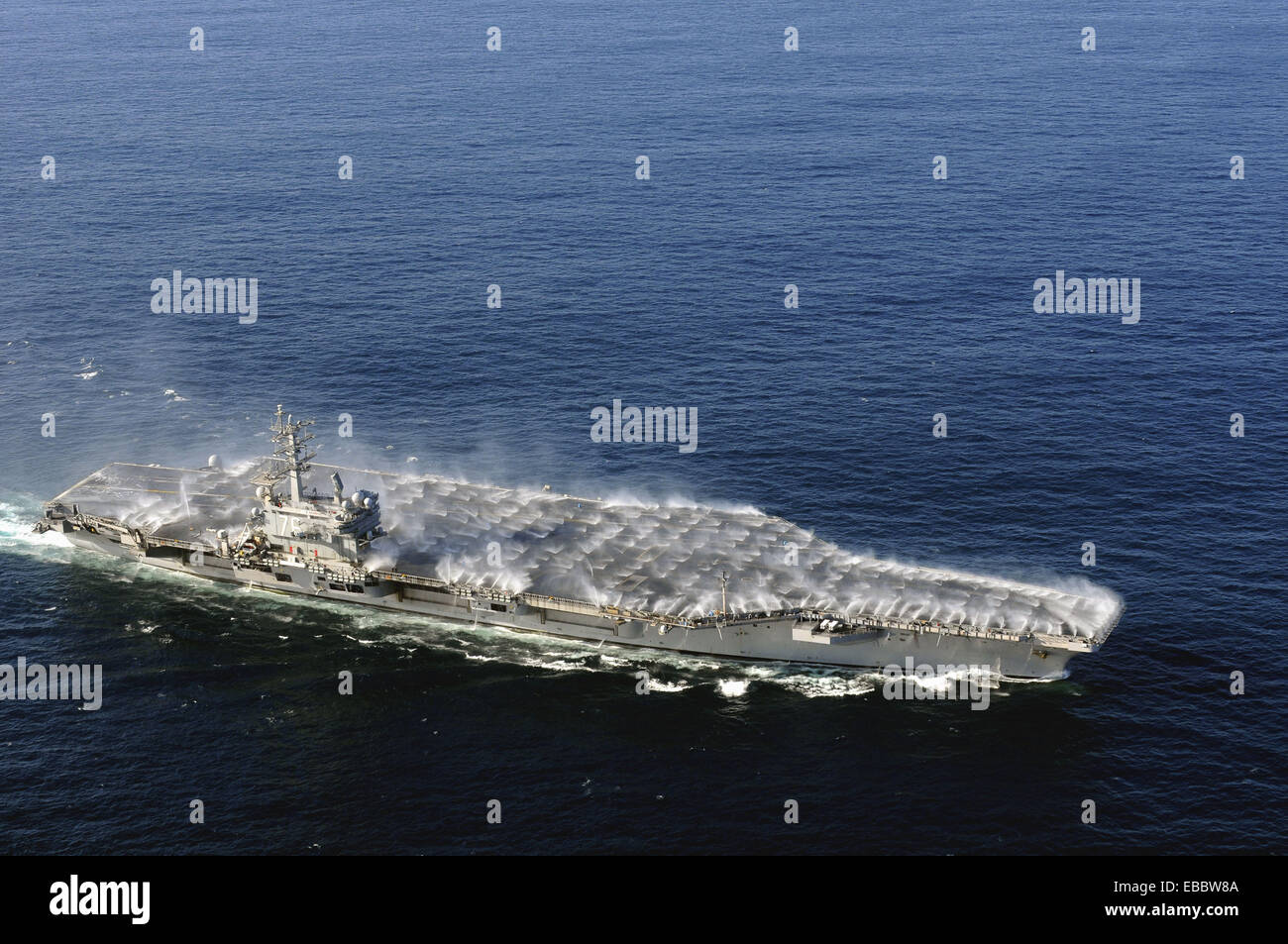 PACIFIC OCEAN (Nov. 24, 2008) Countermeasure wash down sprinklers are activated as the Nimitz-class aircraft carrier - Stock Image