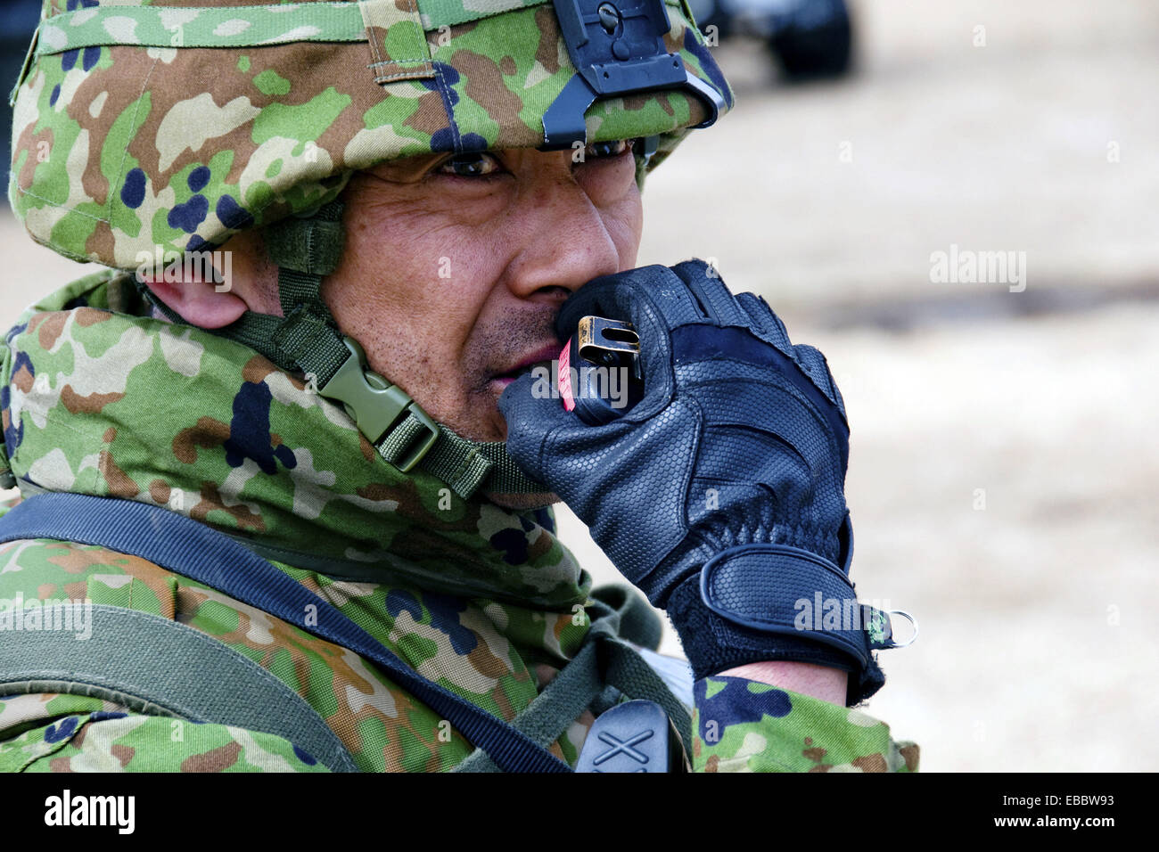 Japan Ground Self-Defense Force 2nd Lt. Fumiko Aizu relays instructions to his troops over a radio during Exercise - Stock Image