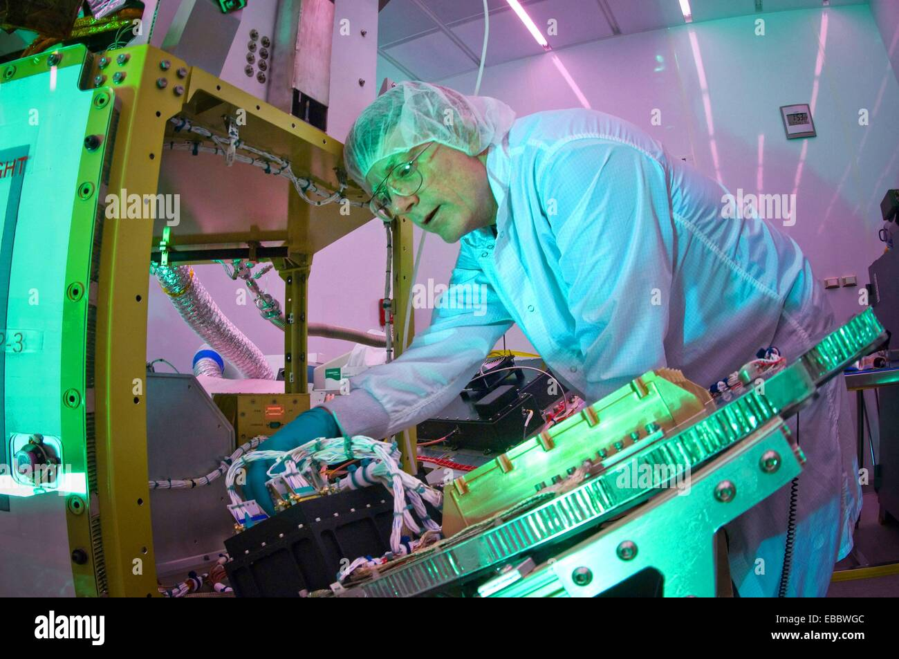 Martin Leahy performs voltage and continuity tests on a tactical satellite, or TacSat-3, at the Air Force Research Stock Photo