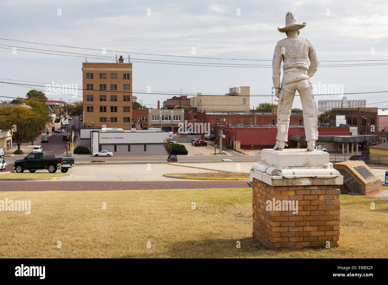 The old cowboy looks down from Boot Hill onto Dodge City, Kansas. - Stock Image