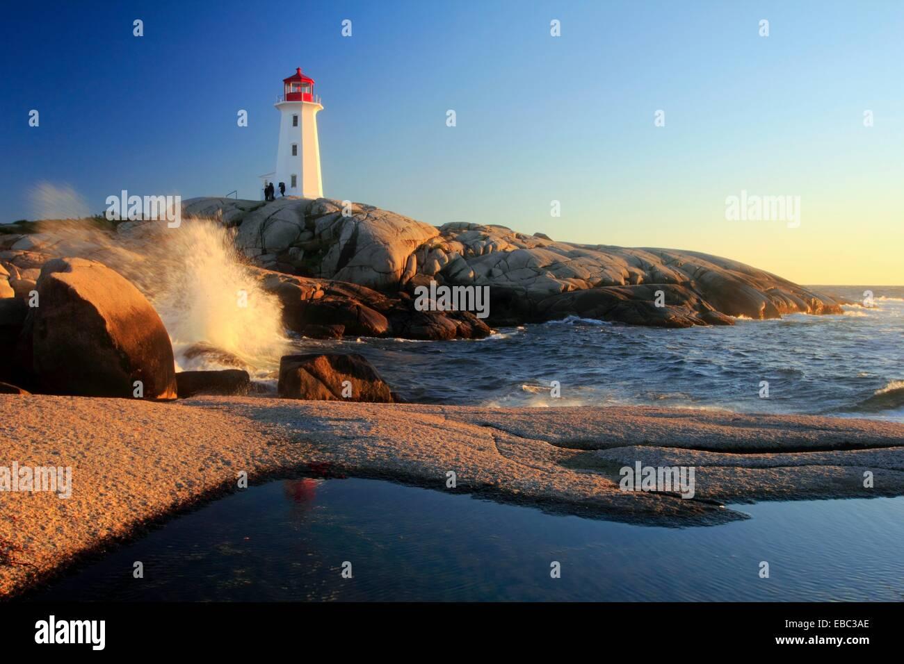 waves crashing on rocks at Peggy´s Cove Lighthouse, Nova Scotia, Canada Stock Photo