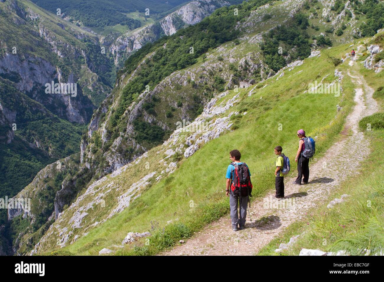 Hikers walking up to Tresviso, a small village in Picos de Europa National Park by historic Urdón path from - Stock Image