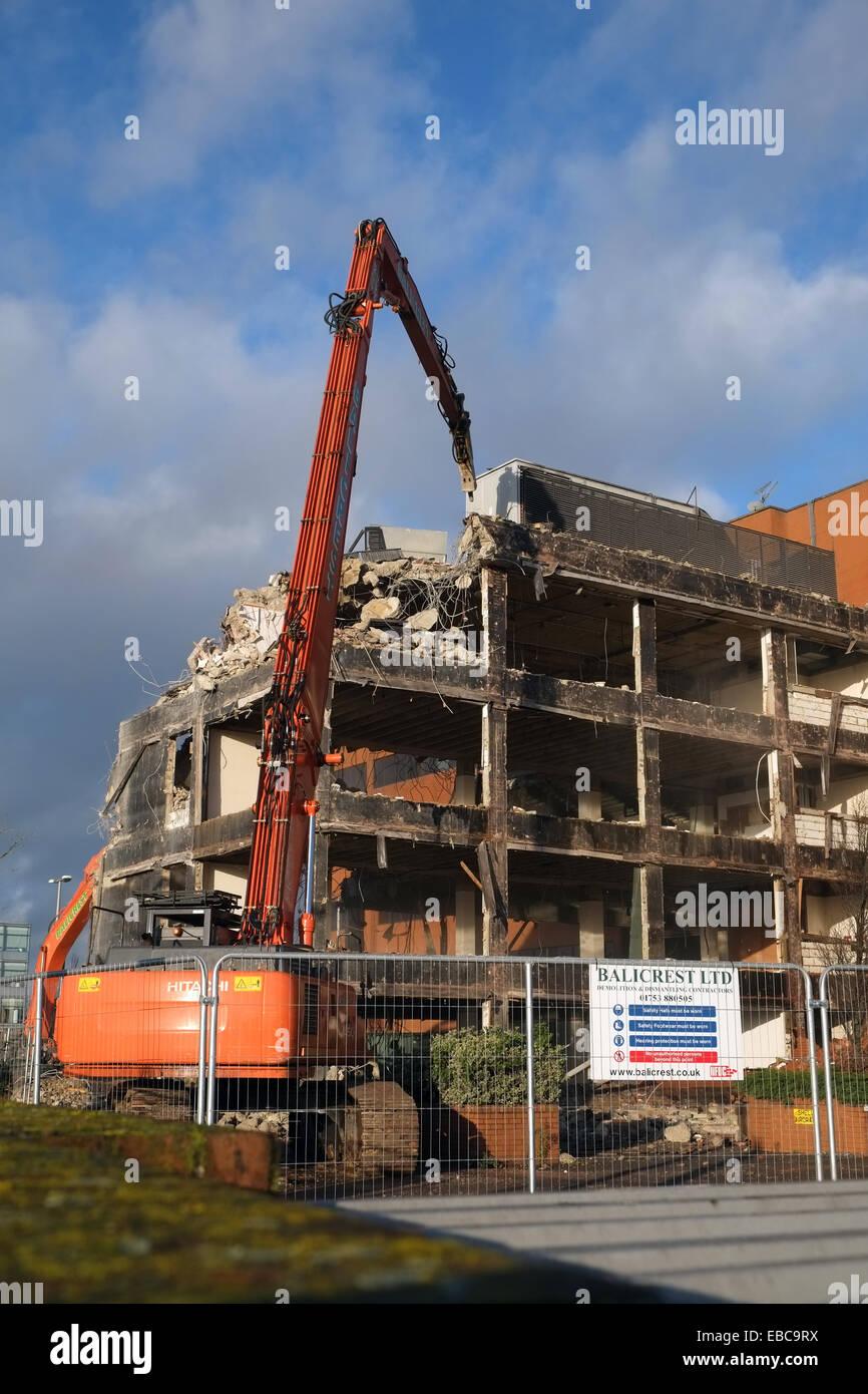 Demolition - machines tear down a building near Heathrow Airport, UK. - Stock Image