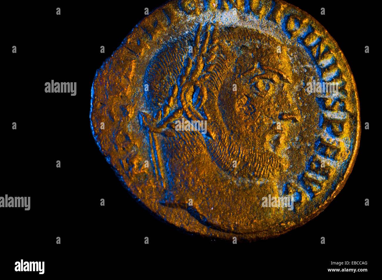 308 to 324 AD Licinius I Roman coin in studio setting - Stock Image