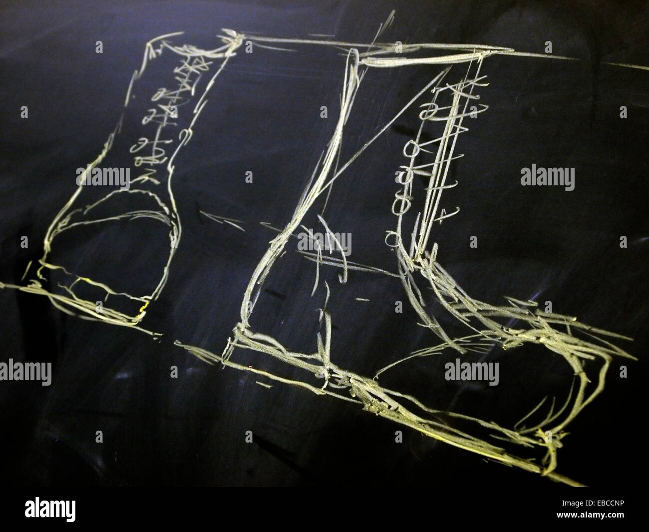 Freehand chalk drawing of two military boots Stock Photo