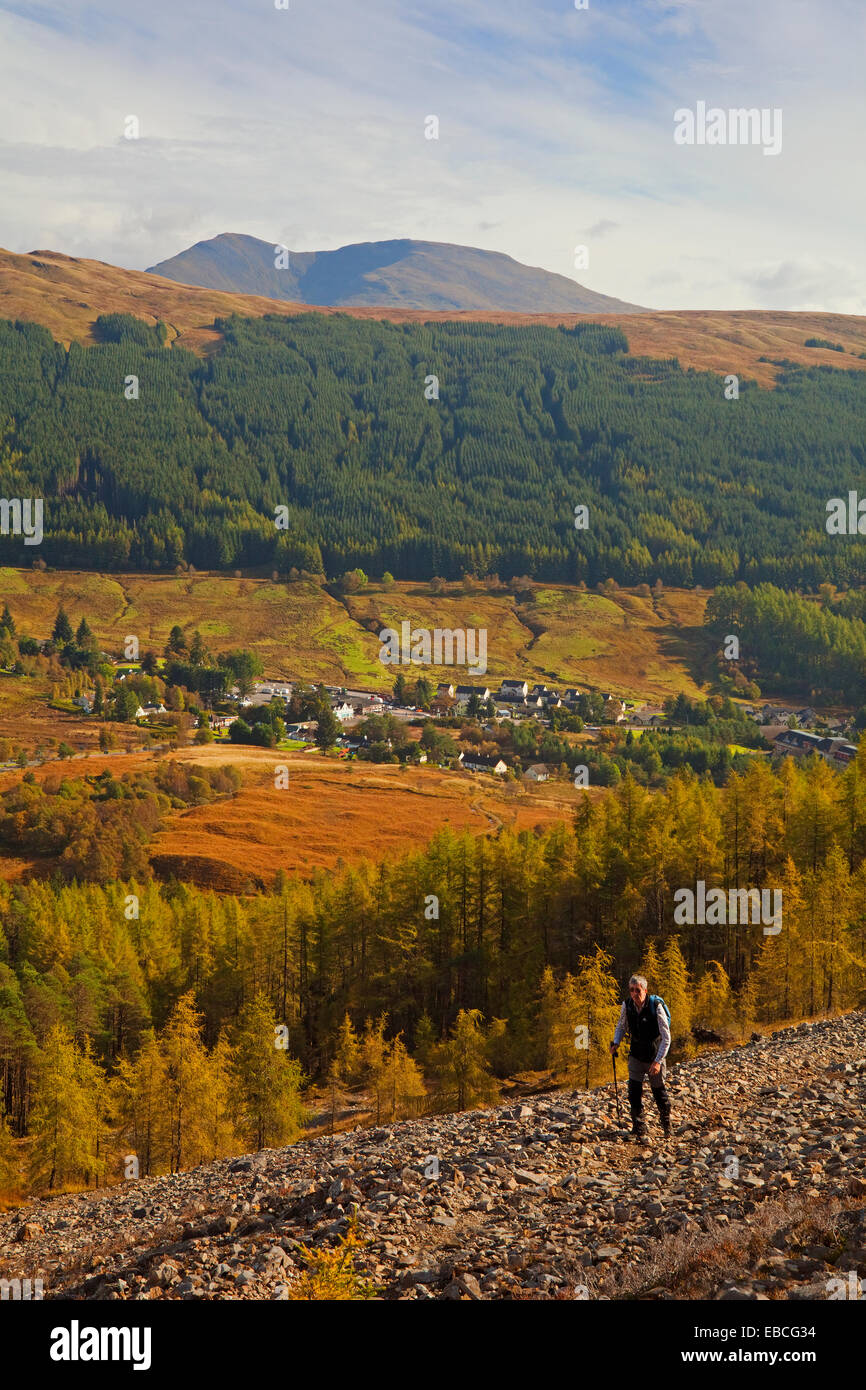 A walker at the old lead mines above Tyndrum, with Beinn Challuim in the background. - Stock Image