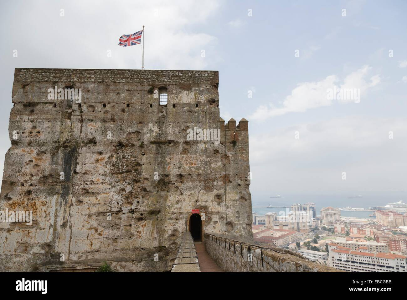 architecture bay body of water British building built structure castle city colony color image day Europe flag Flag - Stock Image