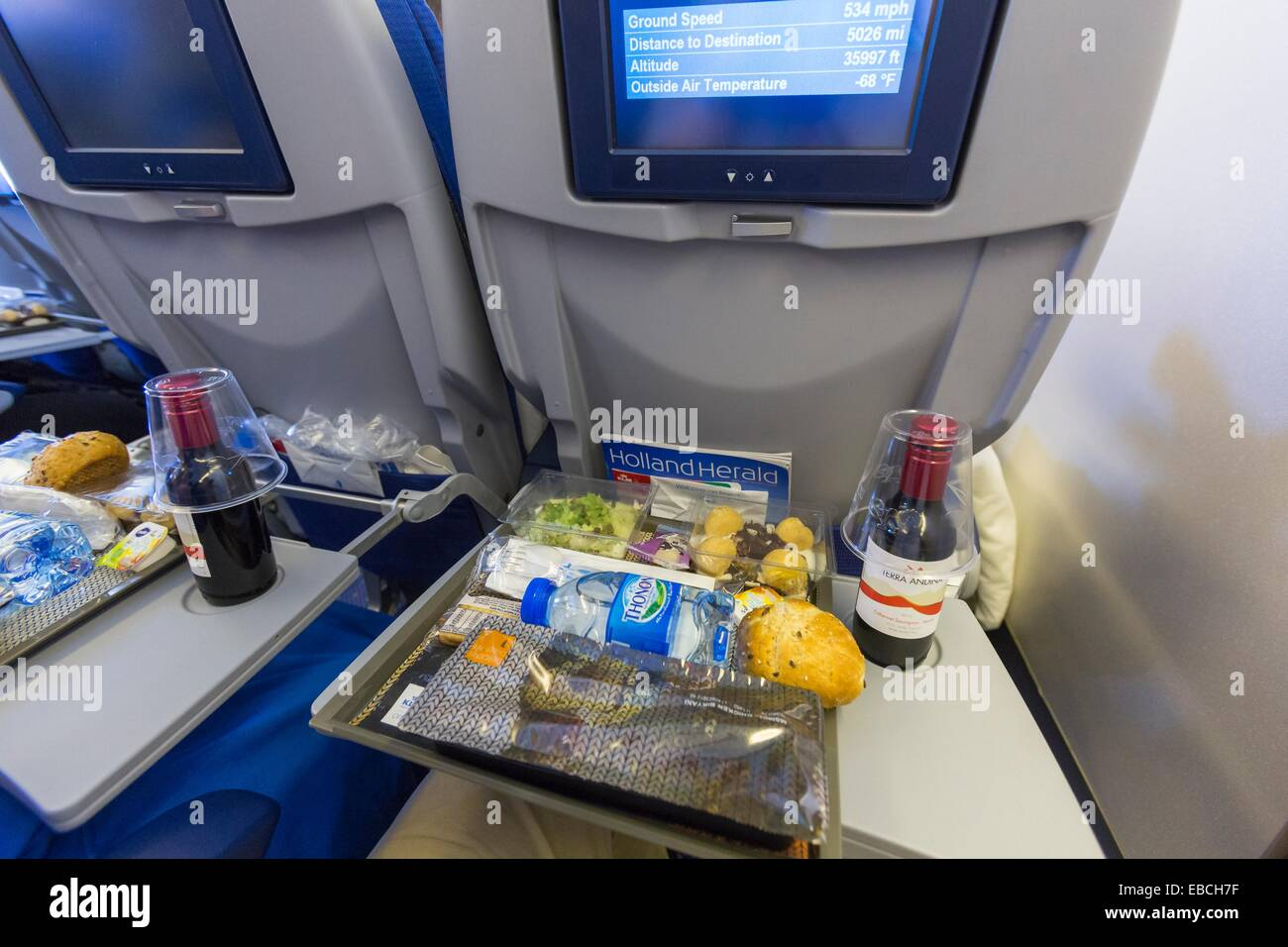 Lunch in Economy Class on board of a commercial airliner - Stock Image