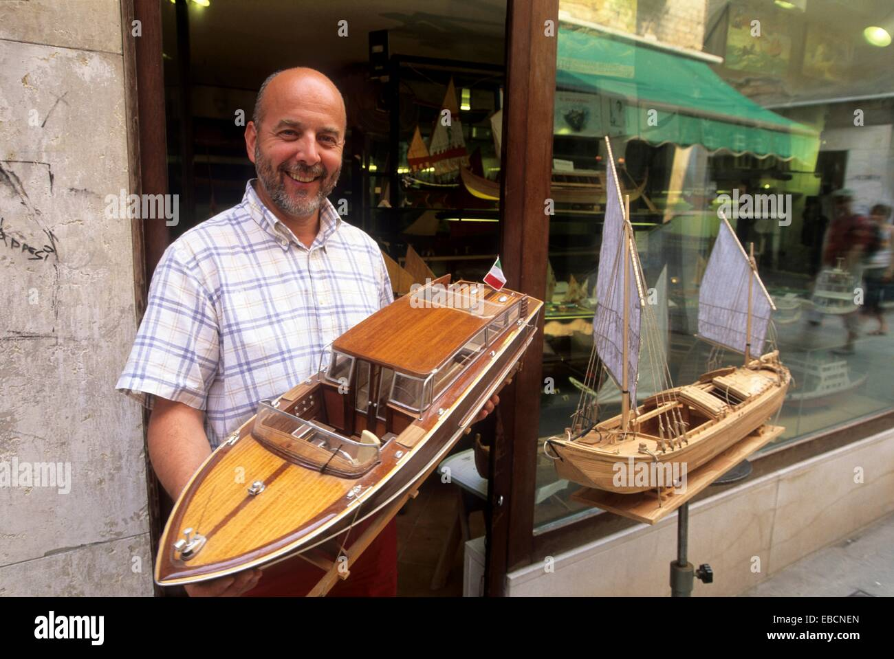 Mr Gilberto Penso holding one of his models, a Venetian taxi-boat, San Polo district, Venice, Veneto region, Italy, - Stock Image