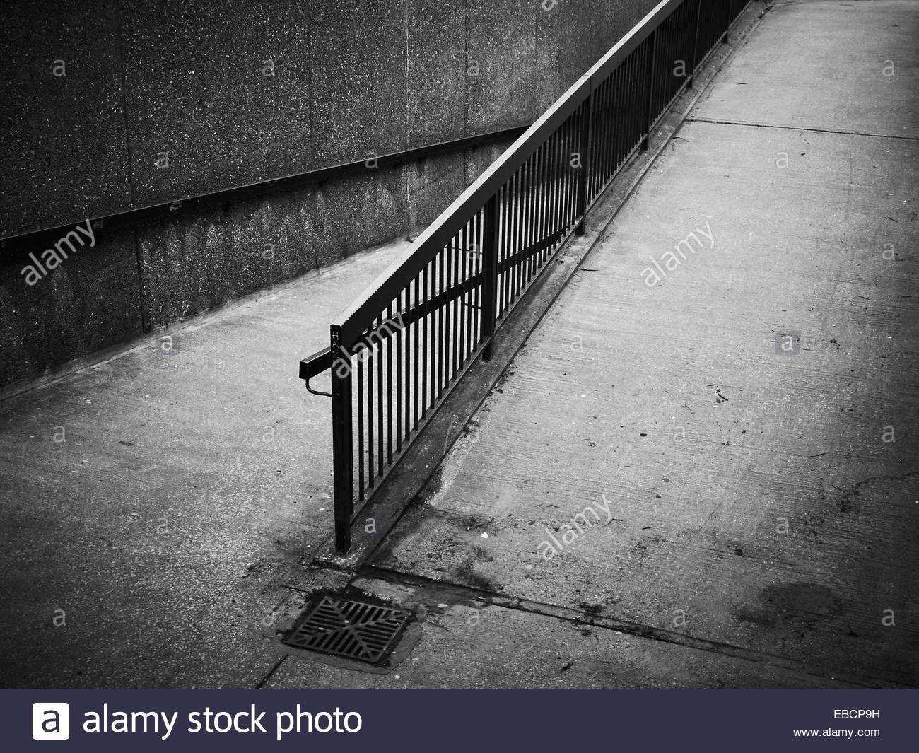 Black and white images of a ramp for disabled people in Chester, Cheshire, UK - Stock Image