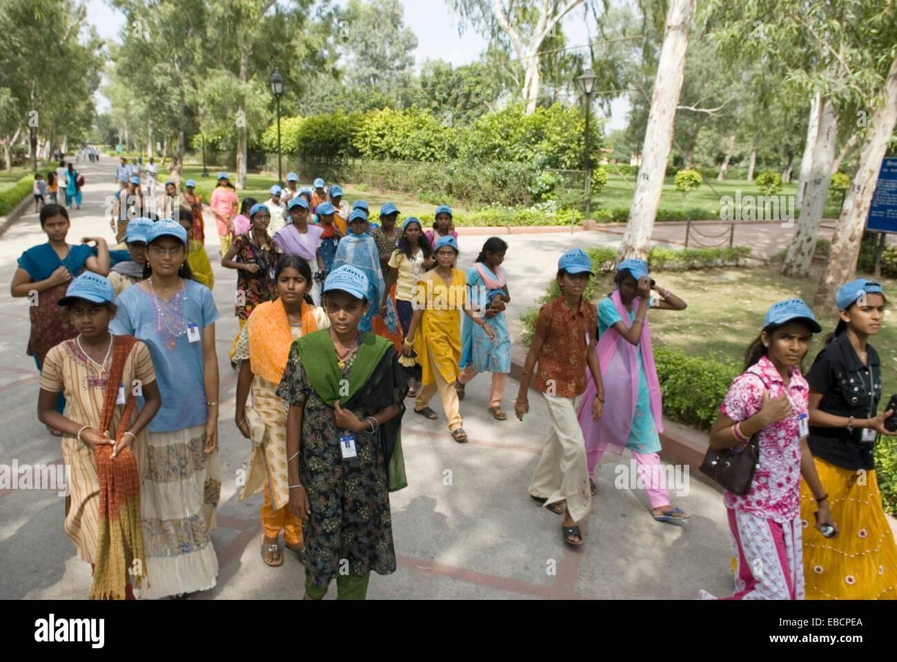 schoolgirls group visiting the Raj Ghat, memorial to Mahatma Gandhi, Old Delhi, India, Asia - Stock Image