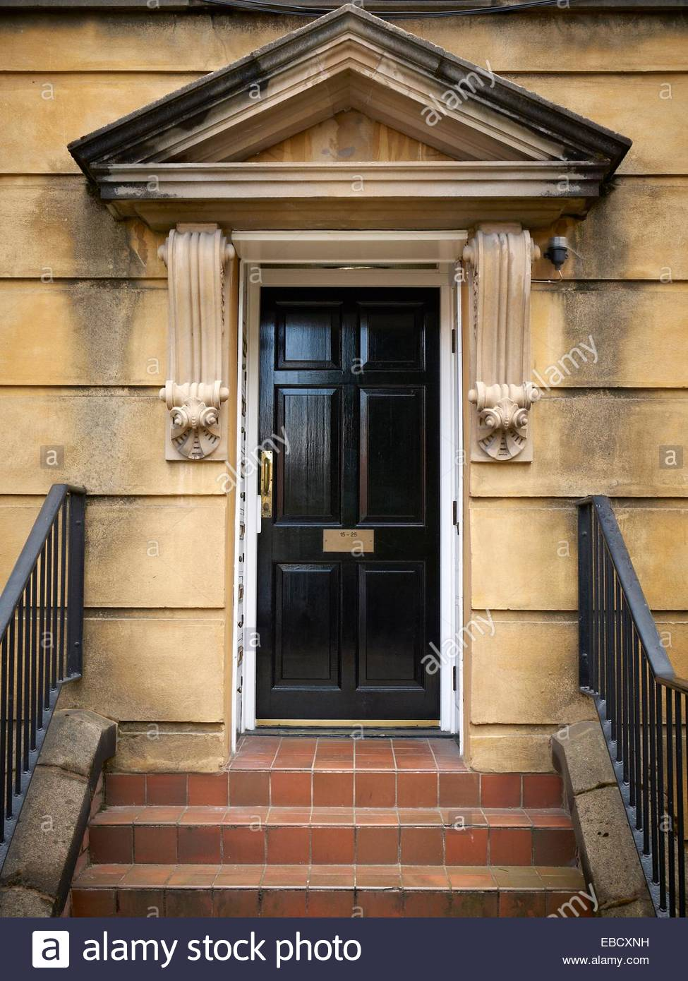 Black Front Door Or Ornate Victorian Entrance With Steps In Stock