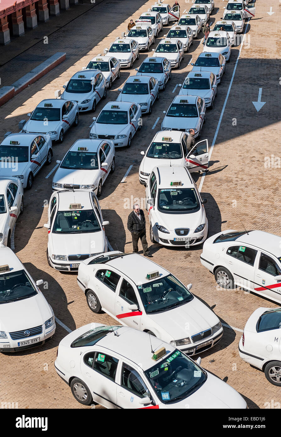 Taxi cabs await passangers at the Madrid Atocha train station, Madrid, Spain - Stock Image