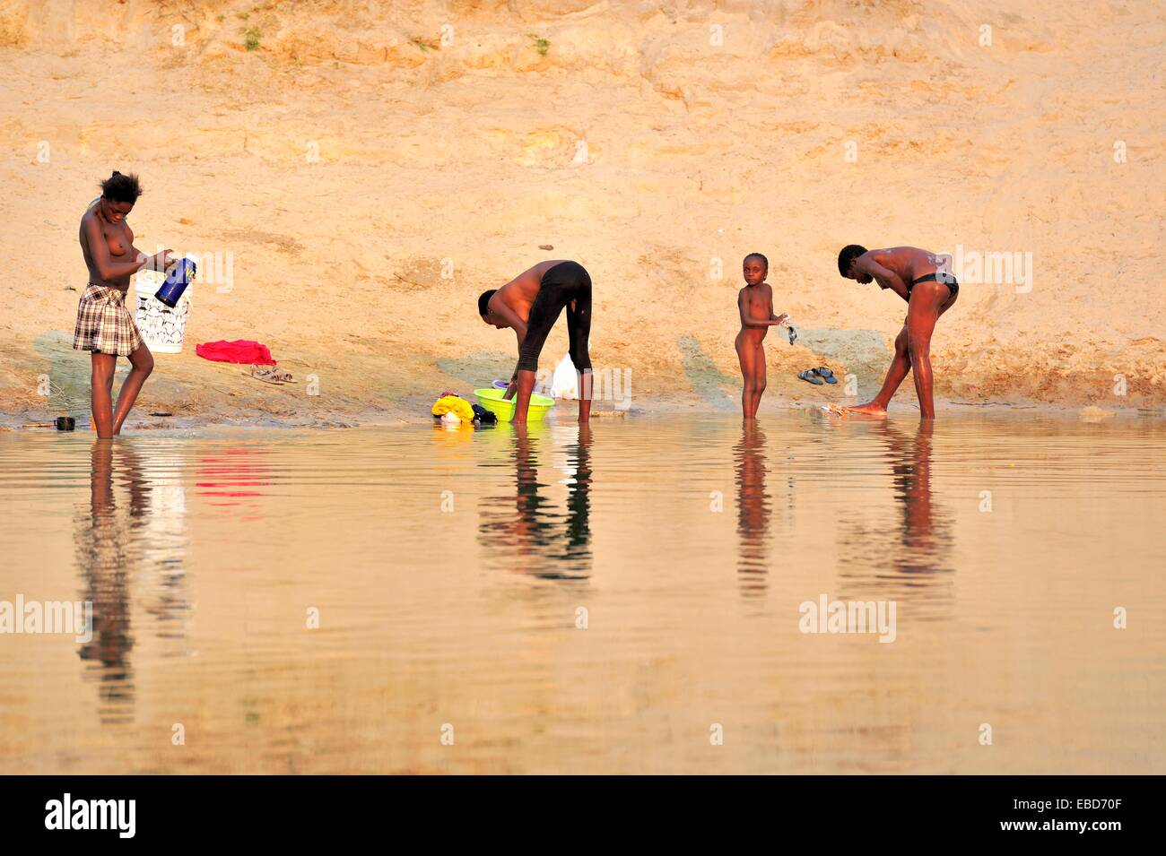 People bathing and washing on Okavango river. Namibia ...