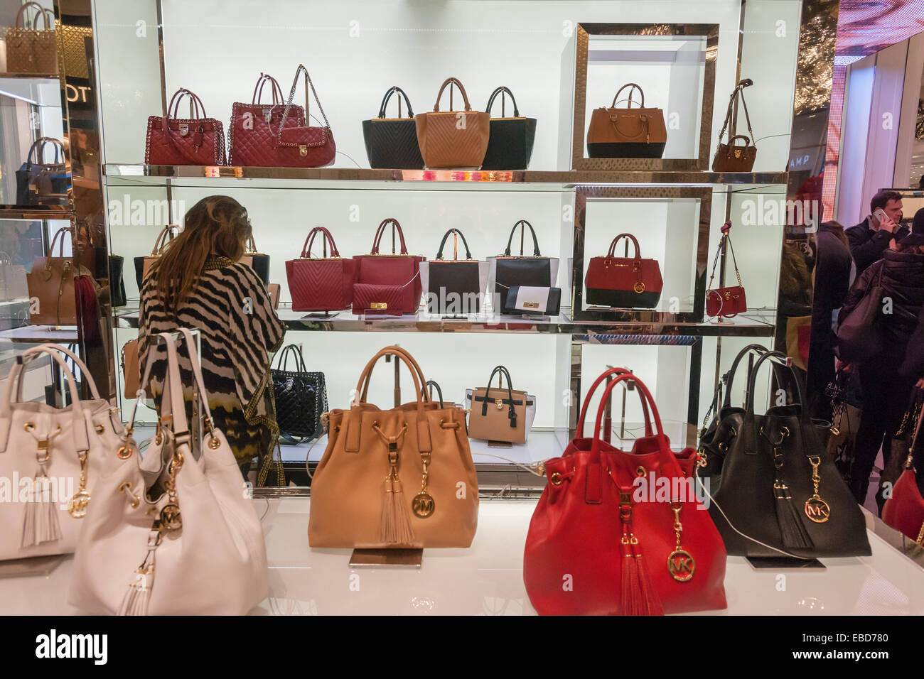 cc247f8528a8 A shopper browses Michael Kors handbags in the Macy's Herald Square  flagship store in New York looking for bargains on the day after  Thanksgiving, ...