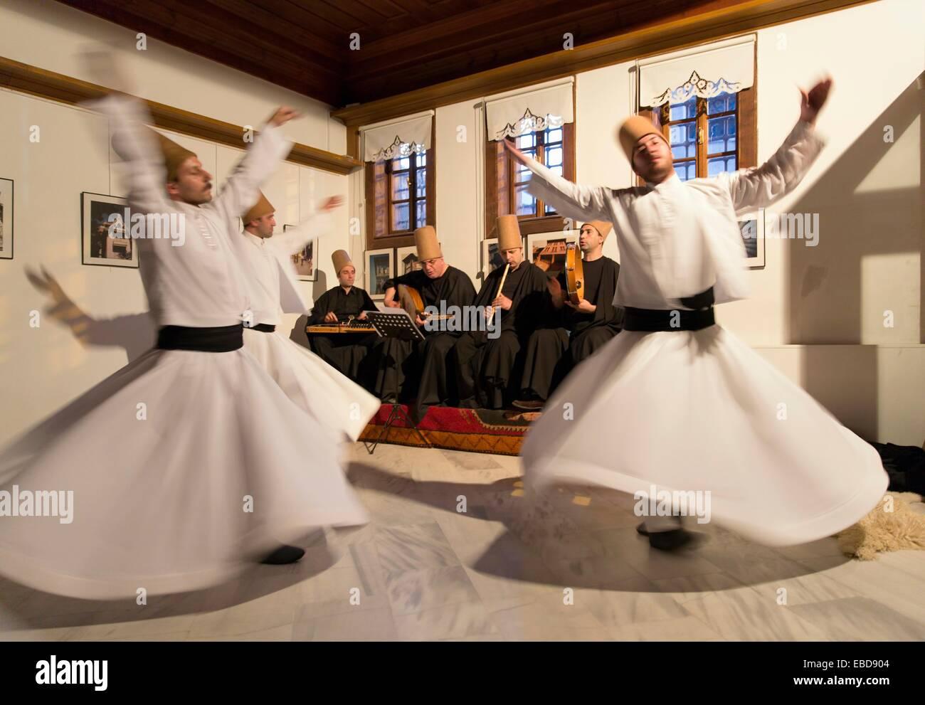 Whirling mystic dervishes perform at Dede Efendi House. Istanbul Turkey. - Stock Image