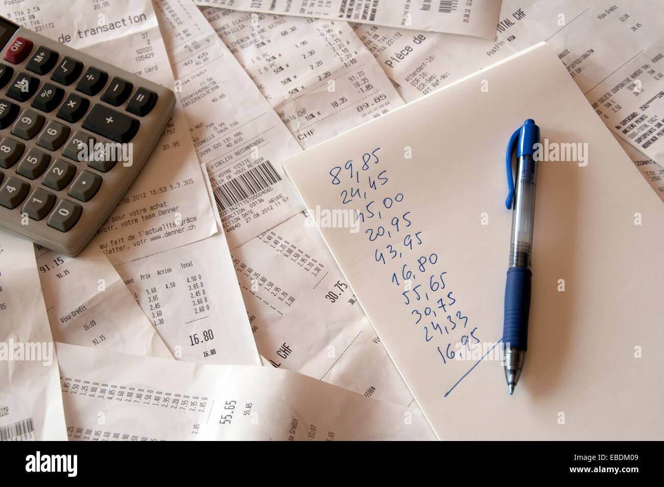 summary of household expenses by collected receipts from supermarkets Stock Photo