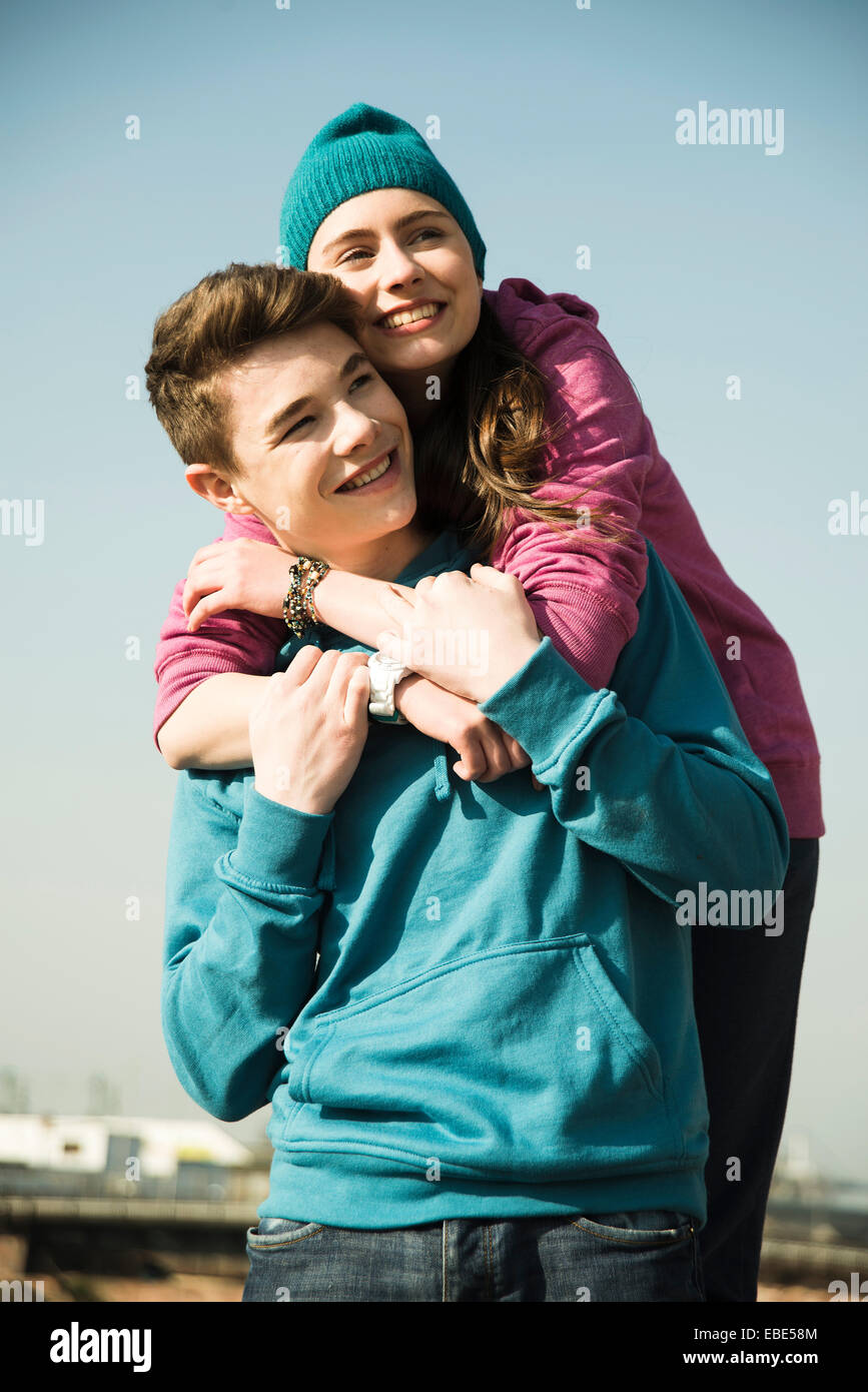 Close-up portrait of teenage couple embracing outdoors, Germany Stock Photo