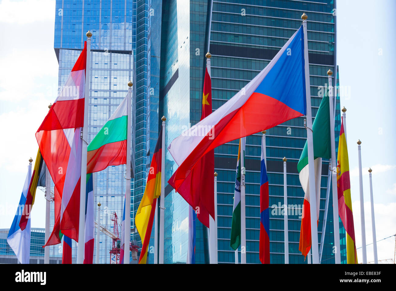 Flags of the different countries against the business center - Stock Image