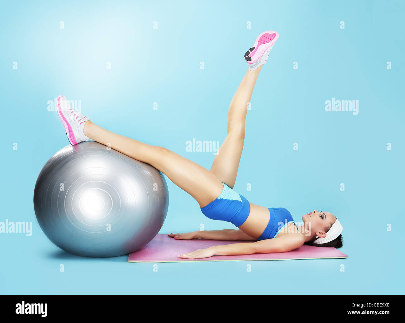 Aerobics. Sportswoman in Sport Club with Fitness Ball - Stock Image