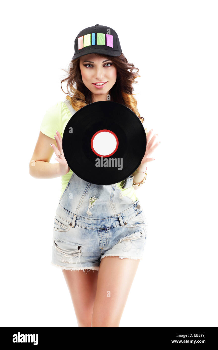 Cute Young Woman in Jeans Shorts holding Vinyl Record - Stock Image
