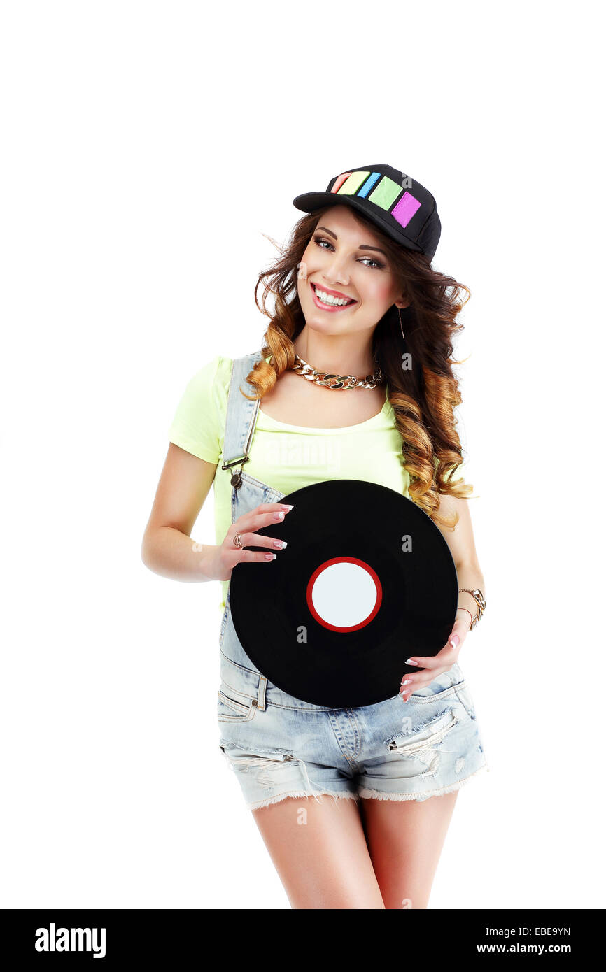 Young Musician in Baseball Hat with Retro Vinyl DIsc - Stock Image