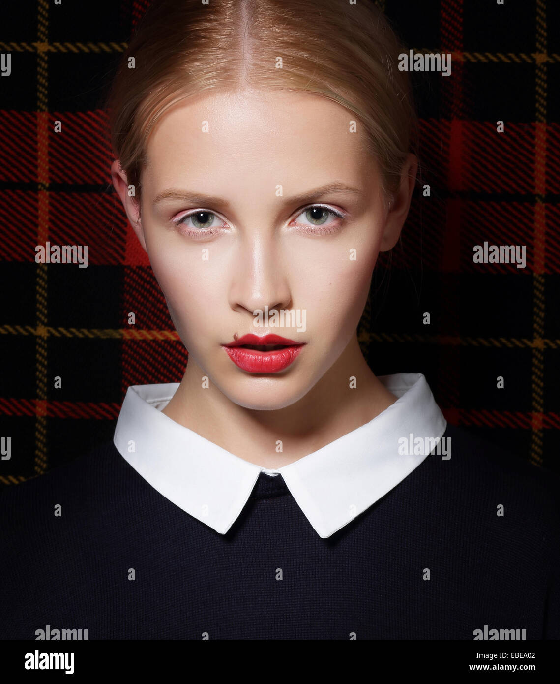Stylish Charismatic Female with White Collar - Stock Image