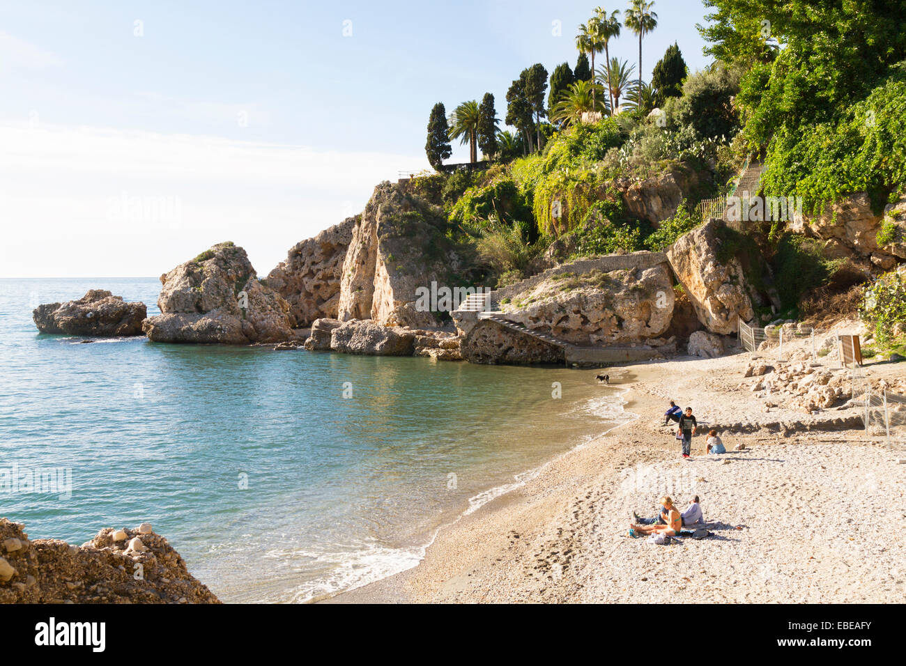 One of the many small sandy coves along the Costa Del Sol in Spain - Stock Image