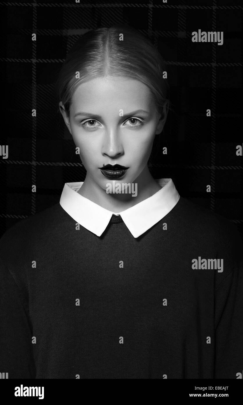 Studio Portrait of Strict Woman with White Collar - Stock Image