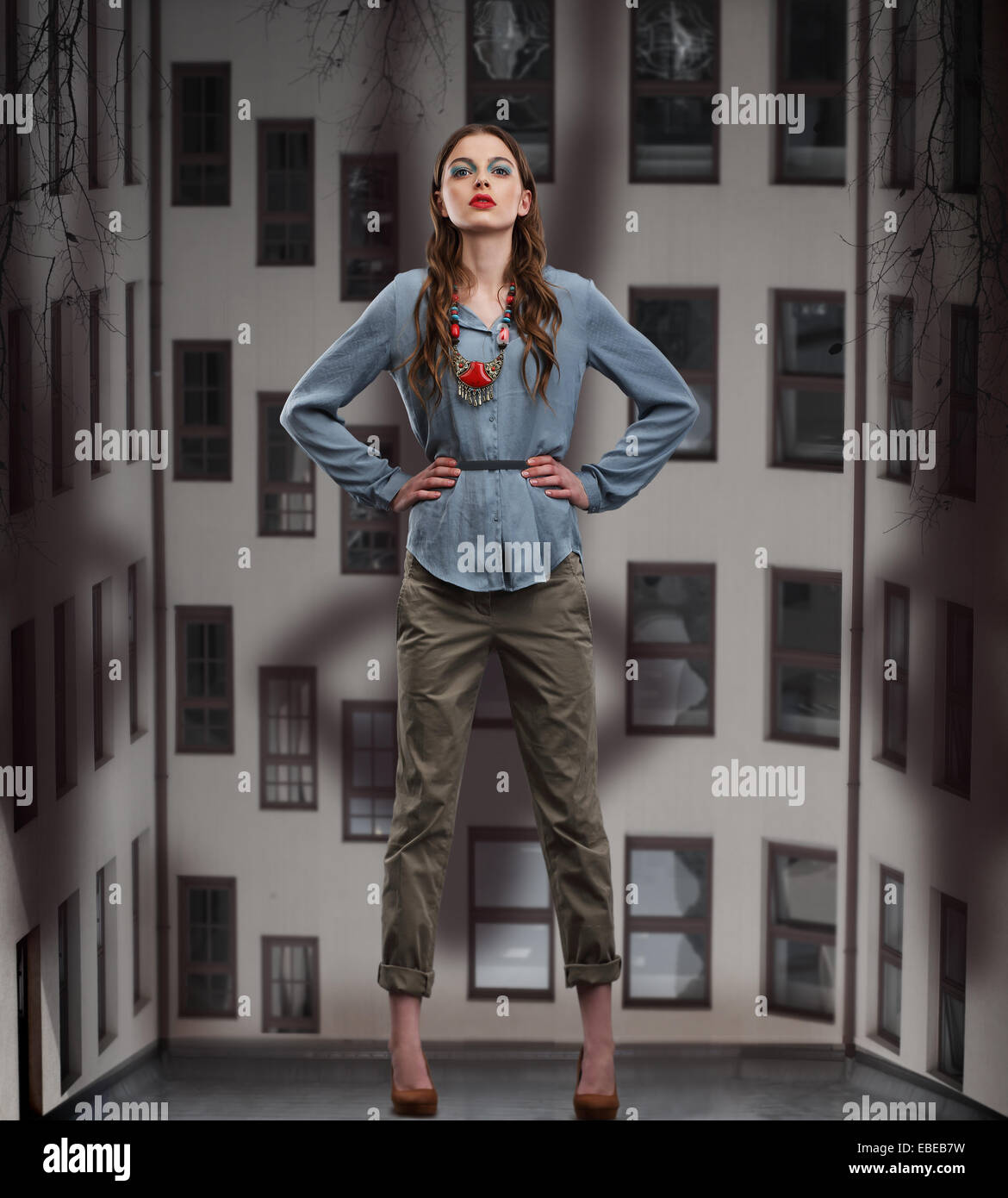 Trendy Woman posing in Pants and Blouse - Stock Image